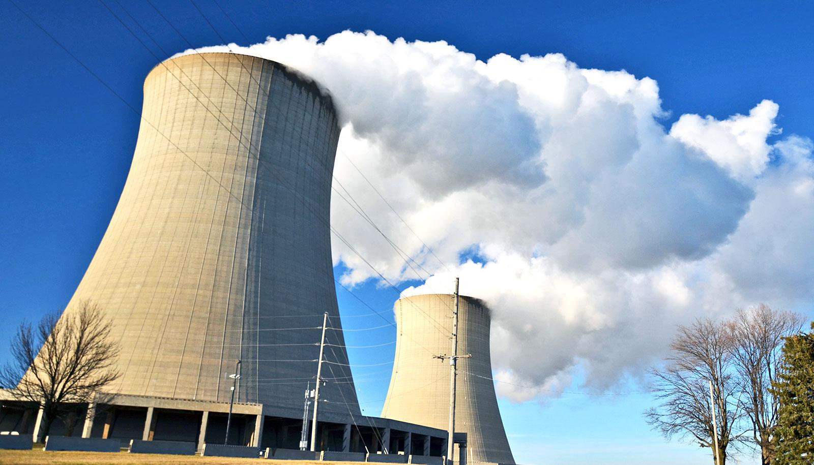 looming nuclear power plant cooling tower