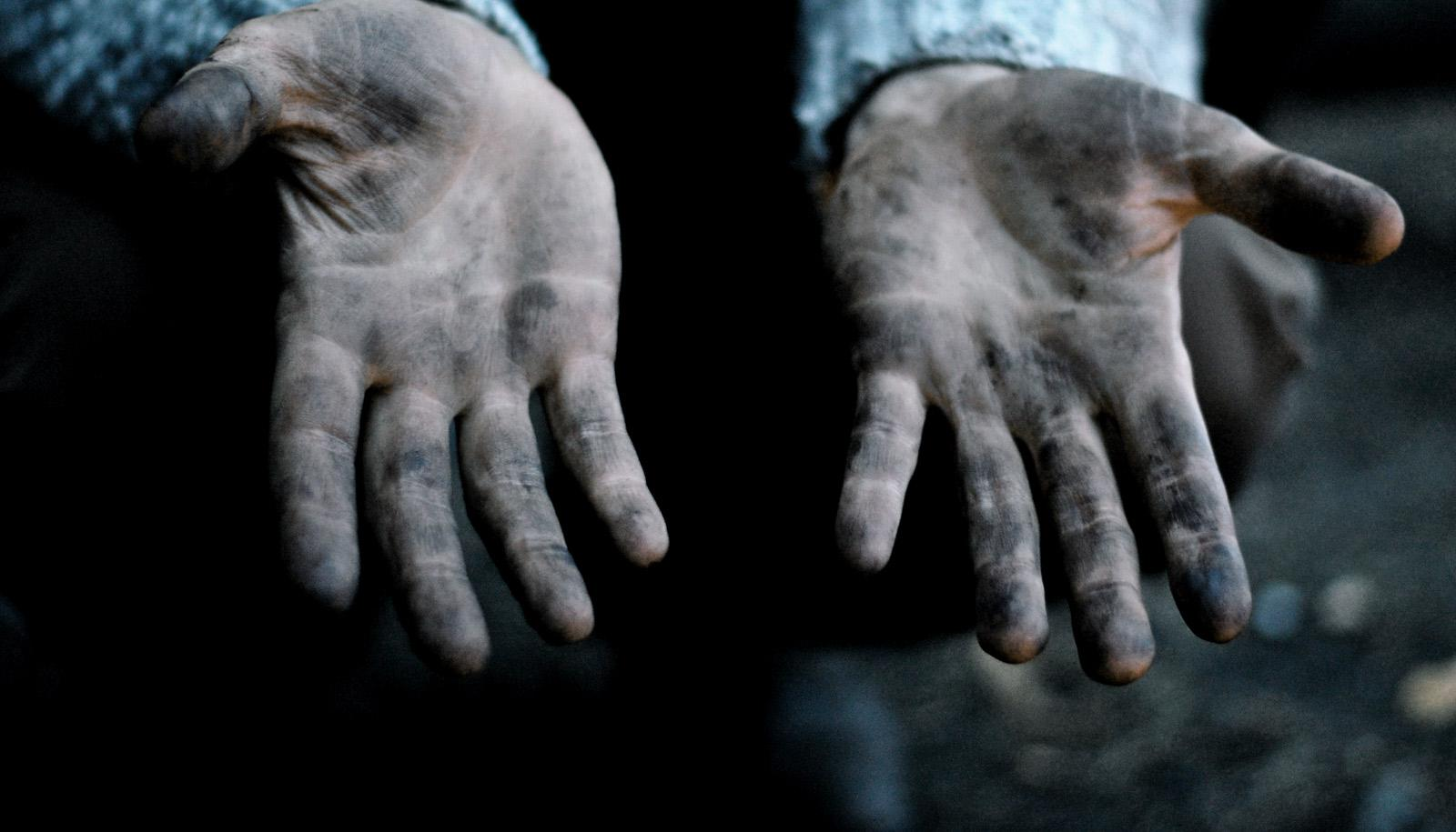 outstretched, muddy hands