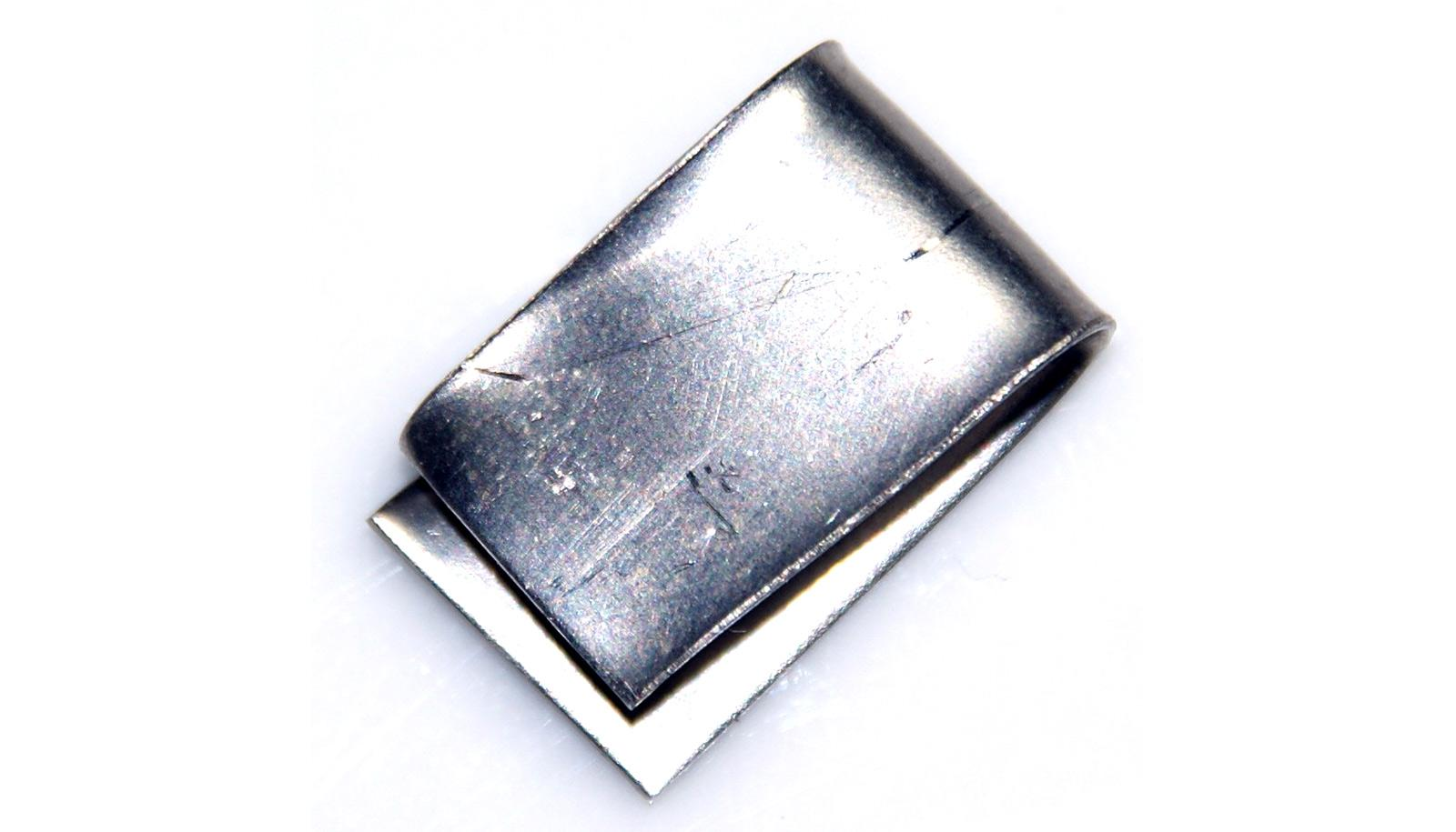 folded sheet of nickel (silver metal) on white