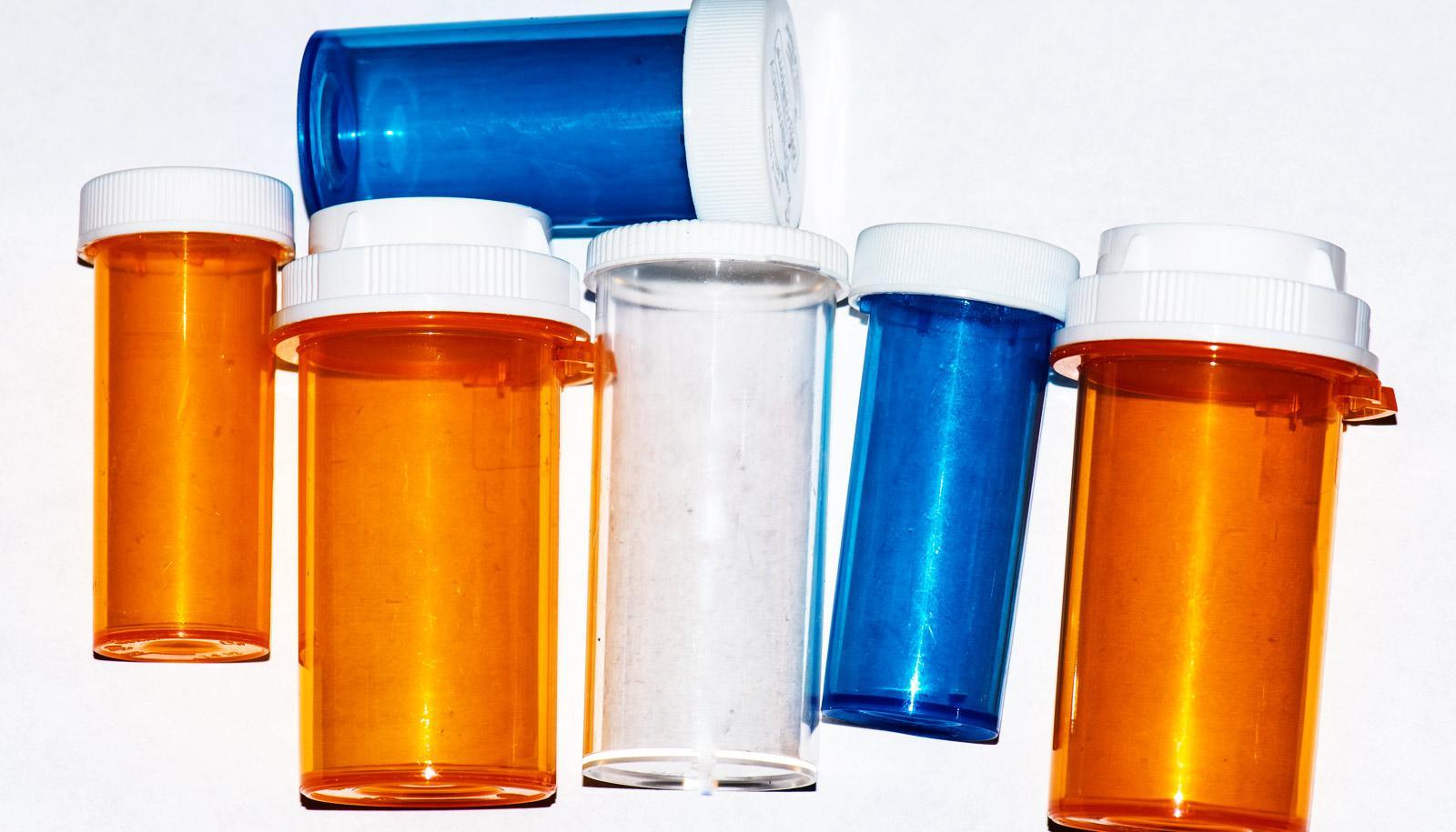 pill bottles on white - generic drugs