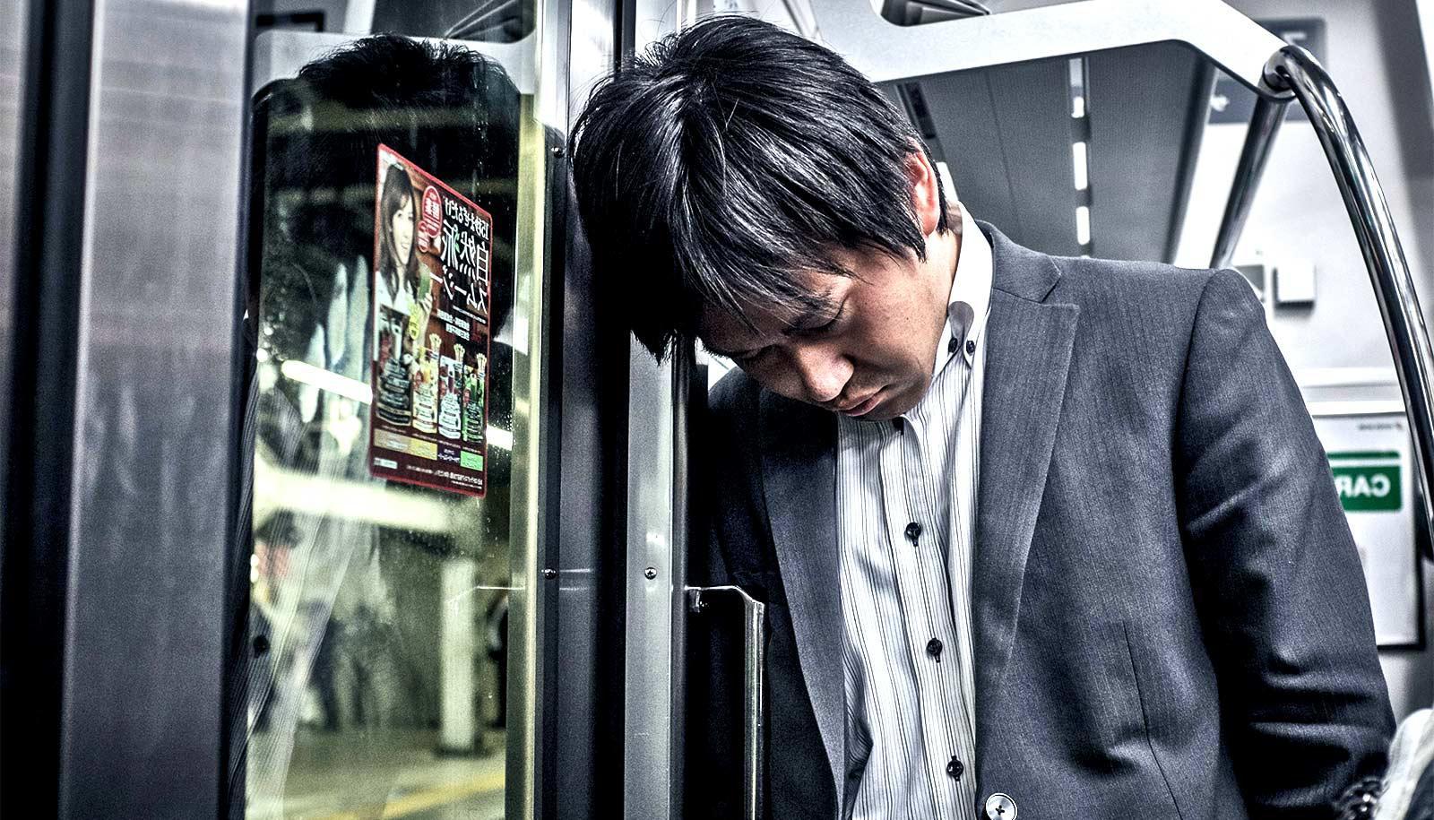 asleep standing on the train