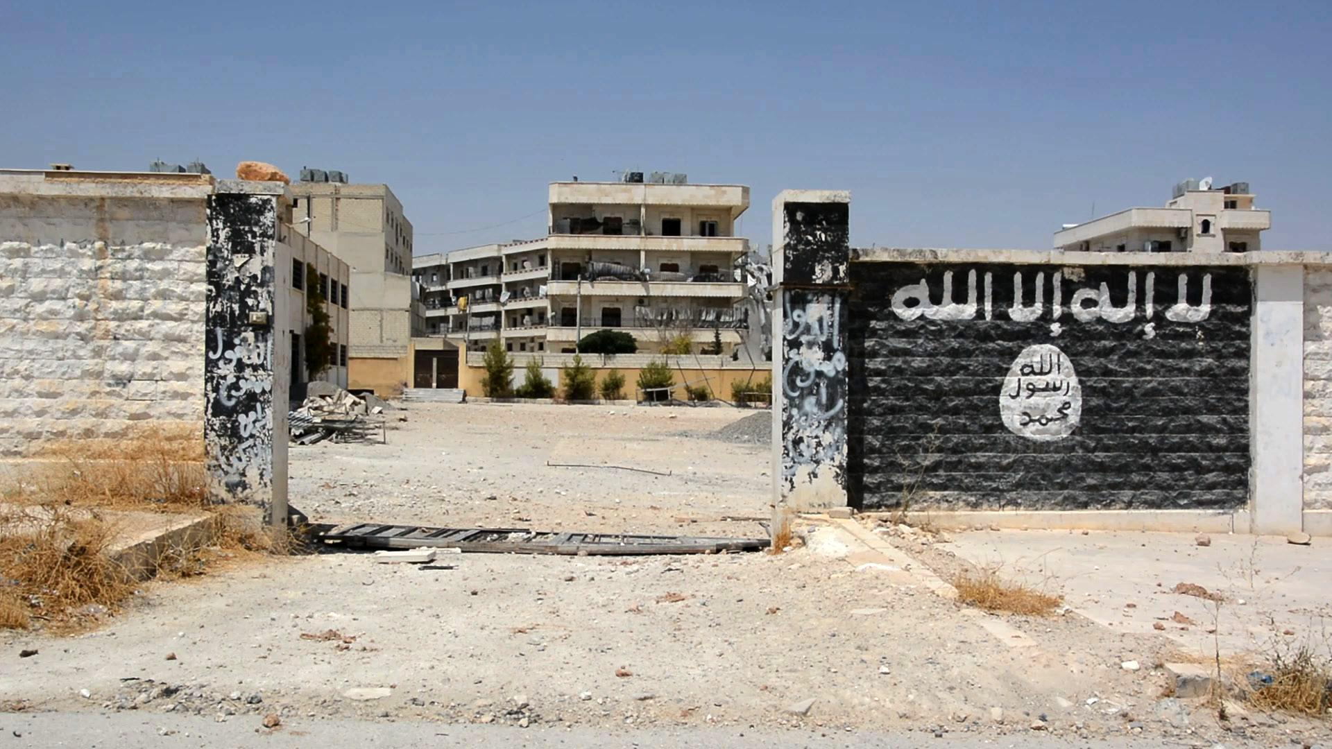 An image grab taken from an AFP video dated August 12 shows a school that was used by ISIS fighters to manufacture explosives in the northern Syrian town of Manbij, almost a week after the Syrian Democratic Forces (SDF), a coalition of Arab and Kurd fighters, seized the group's stronghold.