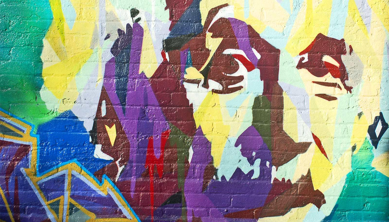 A colorful mural of Albert Einstein's face