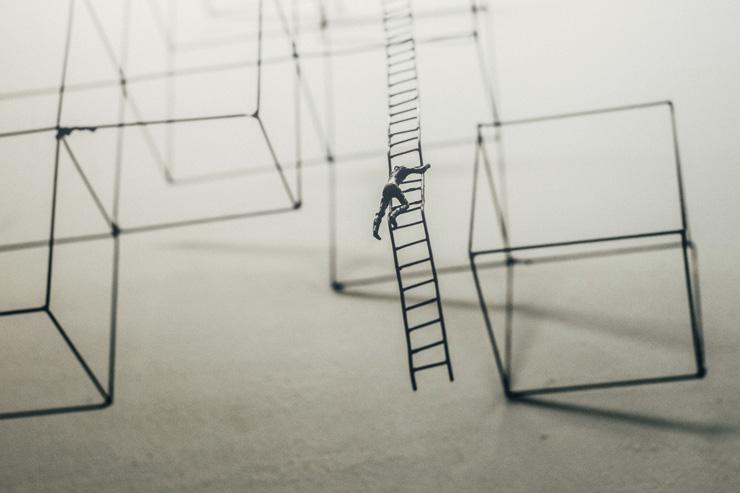 How to Thrive in Times of Change, by Gary Douglas. Illustration of man climbing latter by Jason Wong