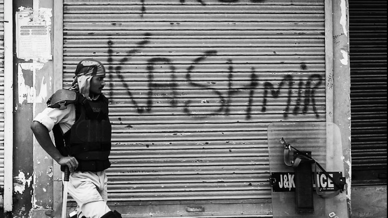 An Indian policeman stands near an alley in the uptown of Srinagar, the summer capital of Indian administered Kashmir. September 11, 2016. Image via Isntagram by Ieshan Wani. Used with permission.