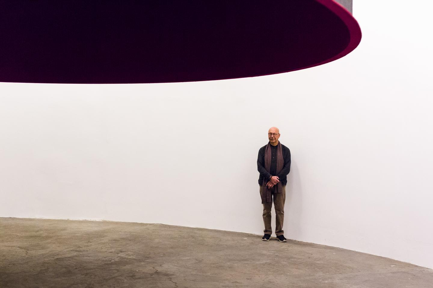 """Vervoordt with an Anish Kapoor installation, """"At the Edge of the World,"""" in Vervoordt's eponymous gallery in Belgium."""