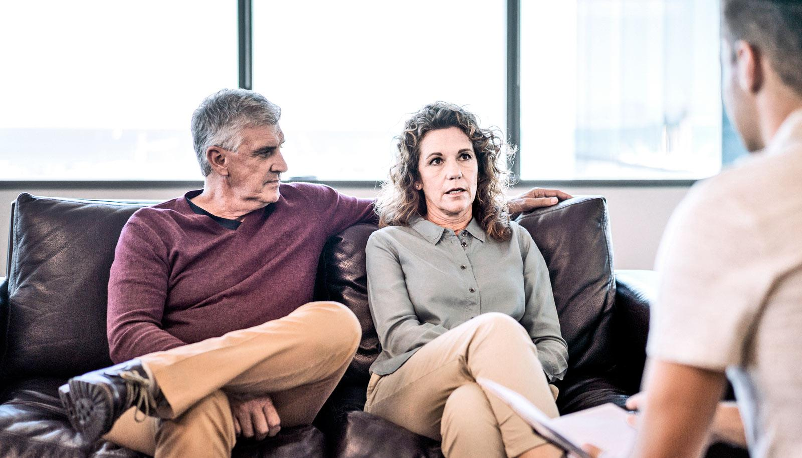 middle-aged couple on couch in counseling