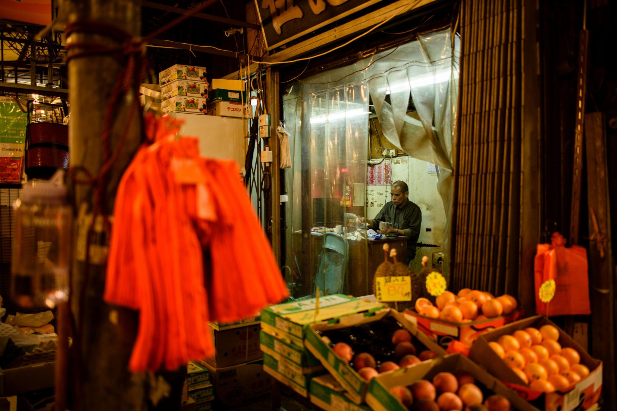 A vendor counts banknotes at the Yau Ma Tei fruit market in the Kowloon district of Hong Kong on March 13, 2017. A new study from the University of Hong Kong suggests that paper money may be a way to monitor the microbes circulating around a city.