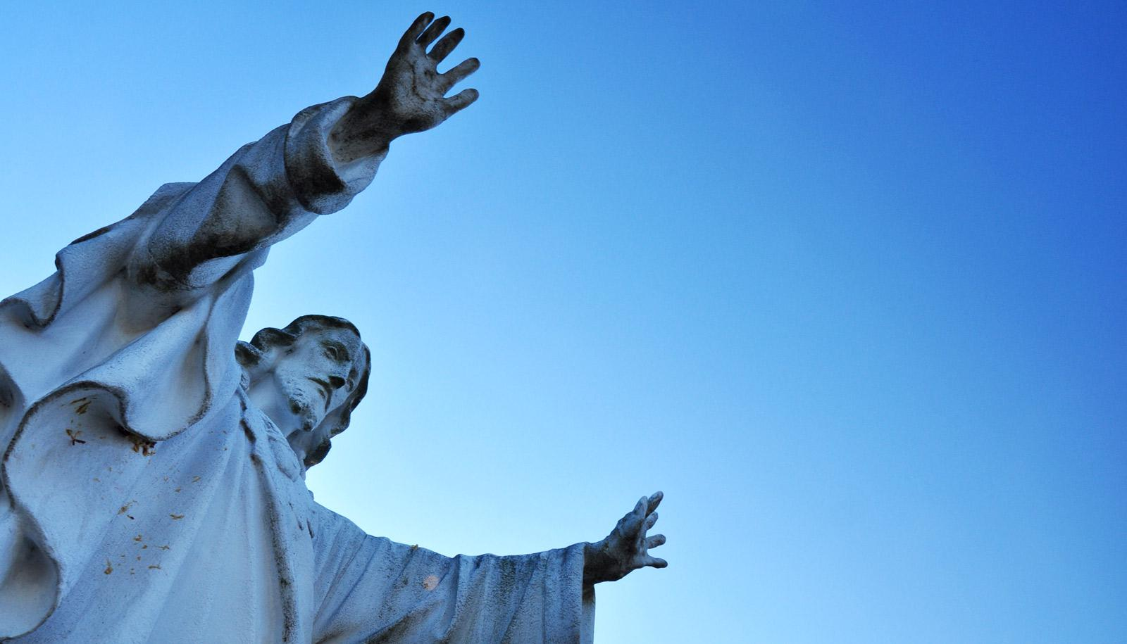 jesus statue against blue sky