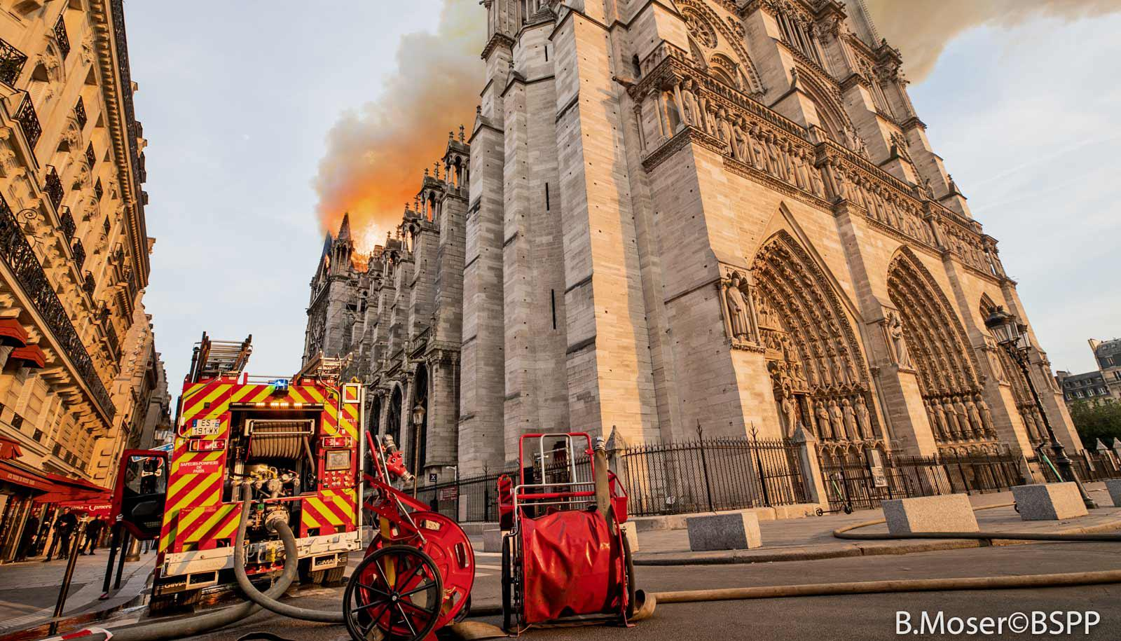 fire truck near Notre Dame as it burns