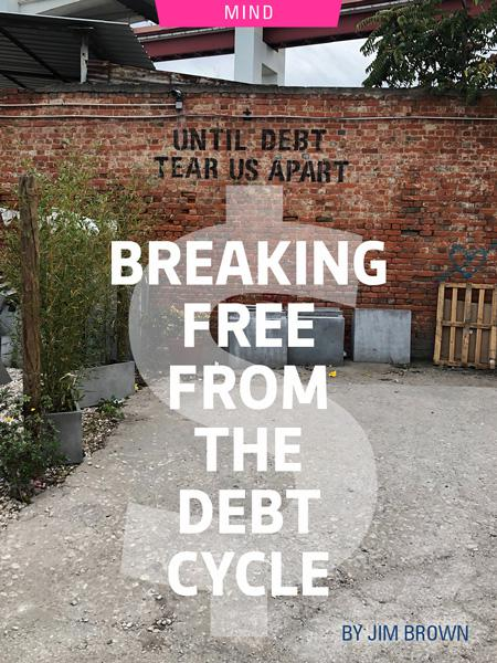 """Breaking Free From The Debt Cycle by Jim Brown. Photograph of a back alley with """"until debt tear us apart"""" painted on the wall by Daniel Thiele"""