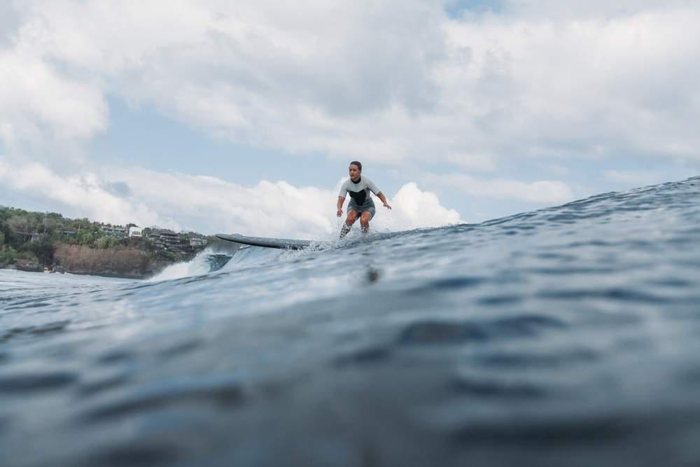 a woman surfing