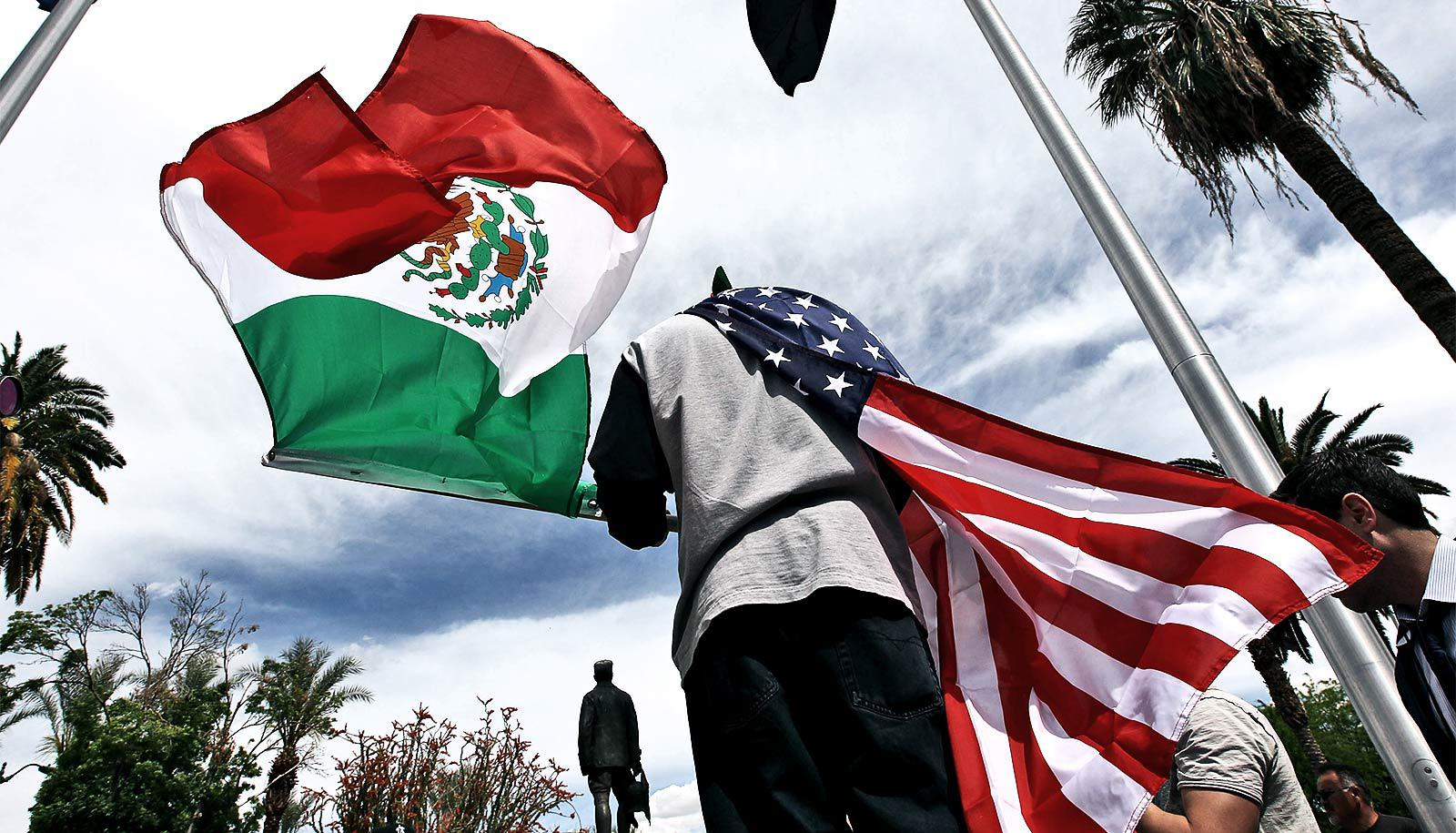 mexican and american flags (immigrants concept)