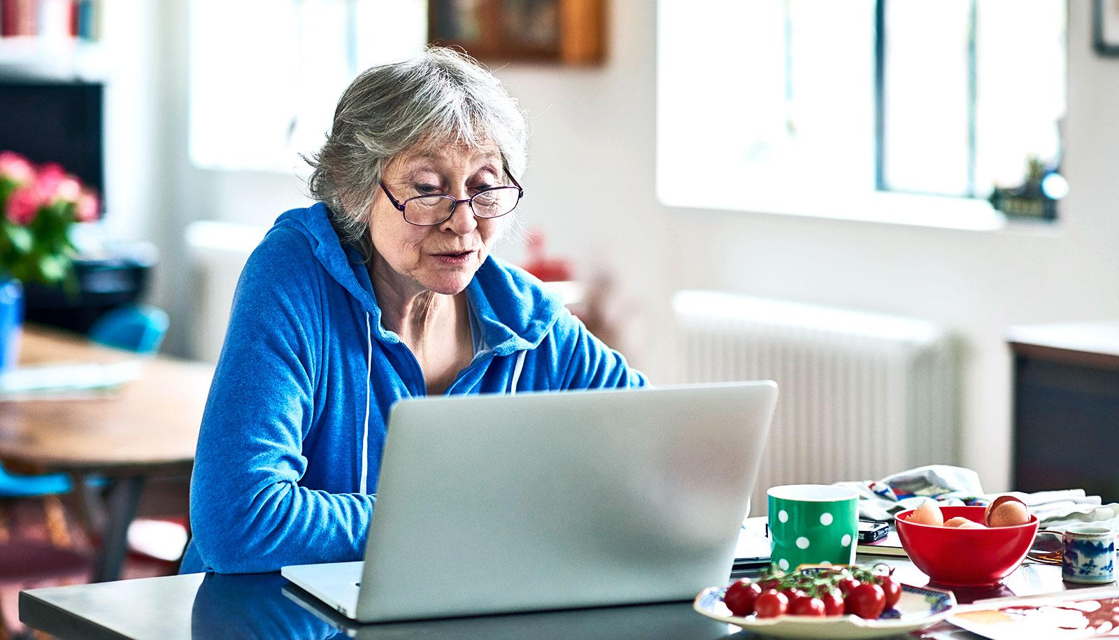 older woman looking at lap top