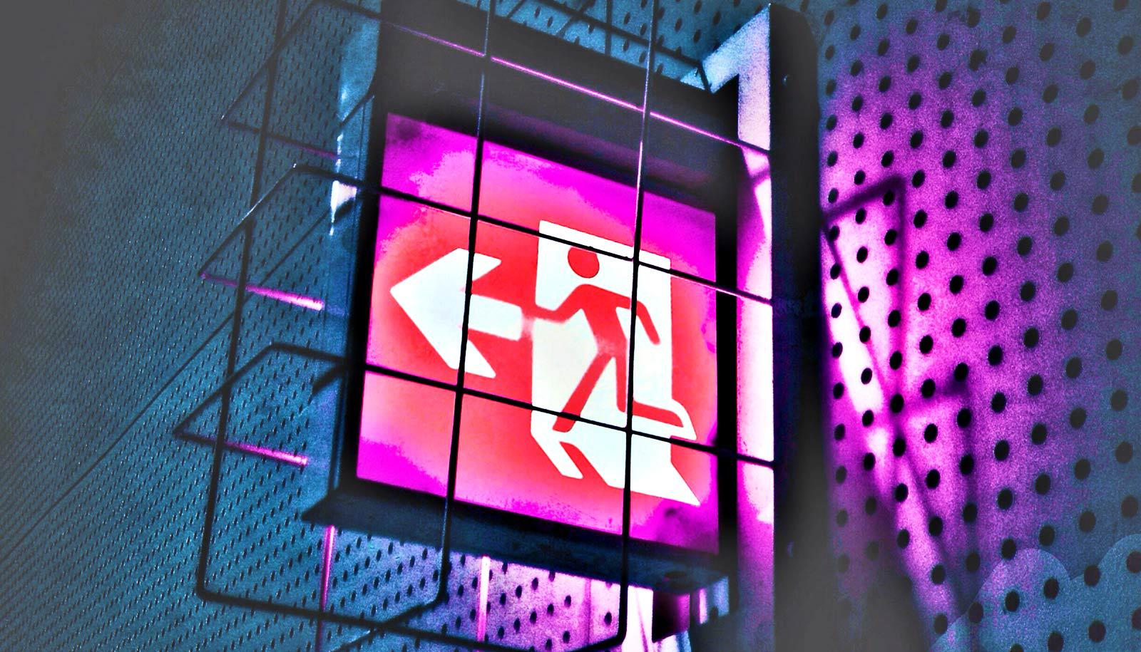 exit sign in cage on wall, purple light