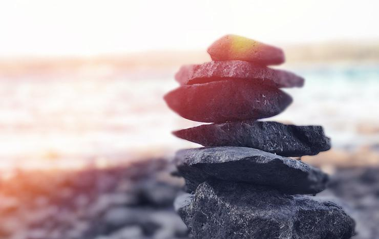 Why and How to Balance Your Hormones for Better Health, by Natalie Niedzialek. Photograph of balancing rocks by Andre Guerra