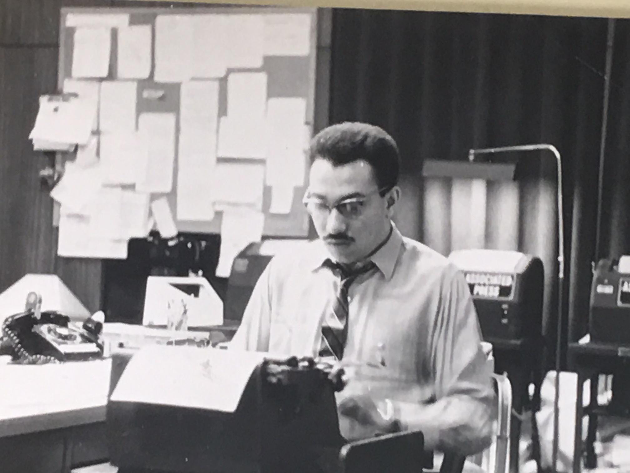 Richard Gibson working as a journalist for CBS Radio News.
