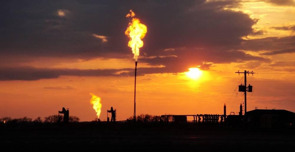 an oil field at sunset