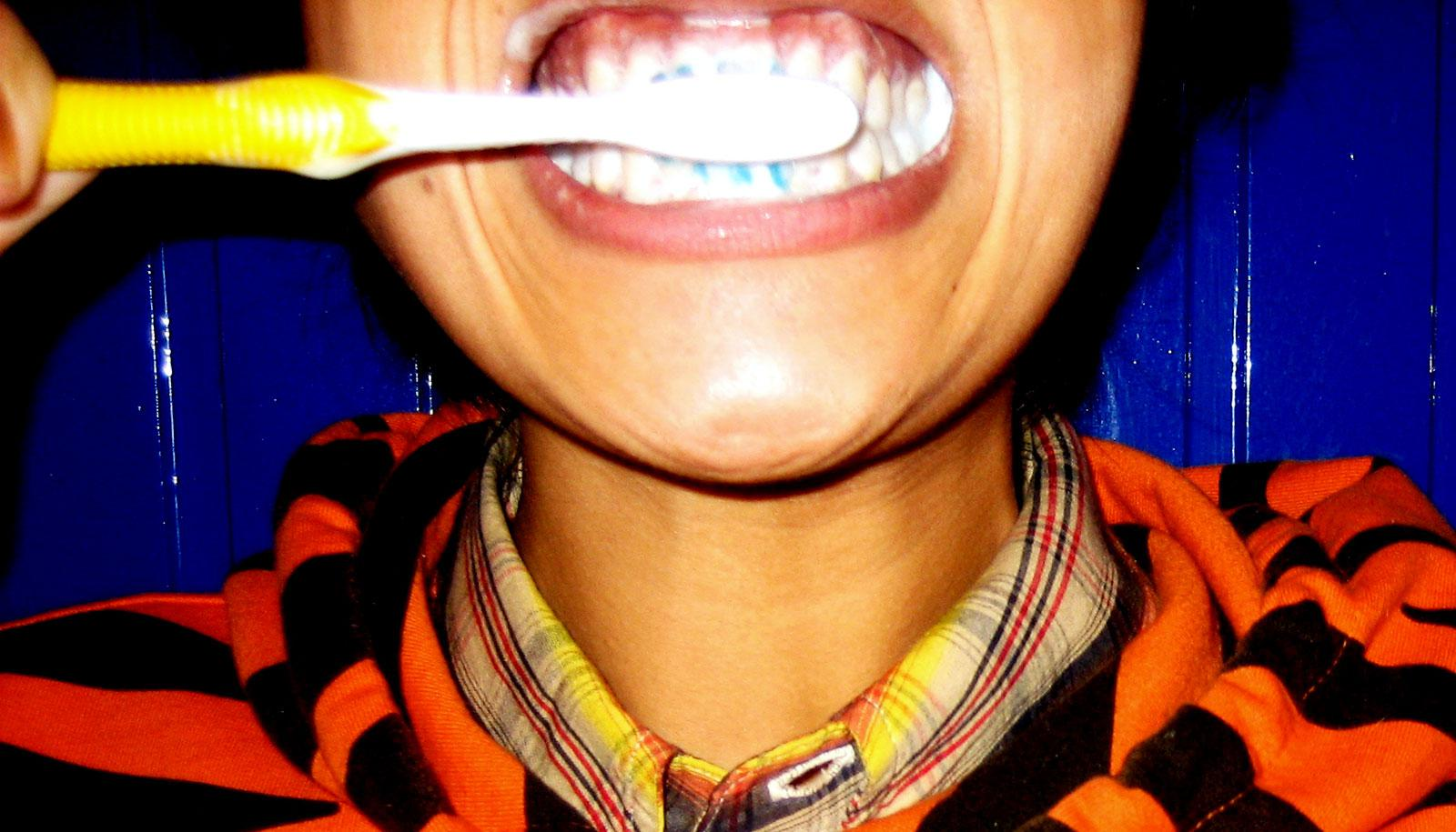 brushing teeth in tiger hoodie (triclosan concept)