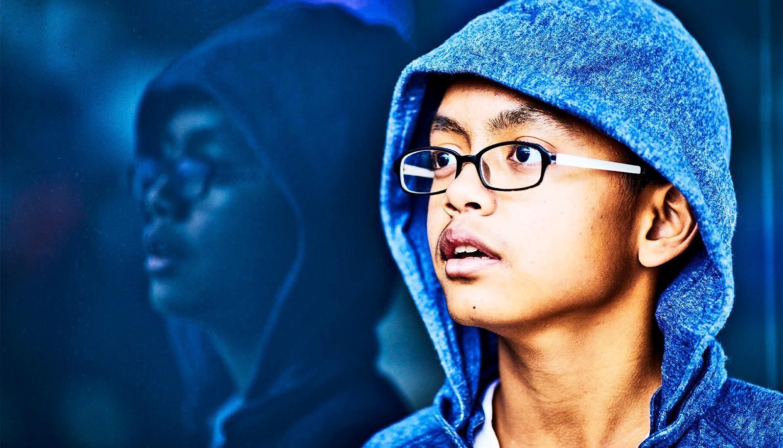 nervous student in blue hoodie