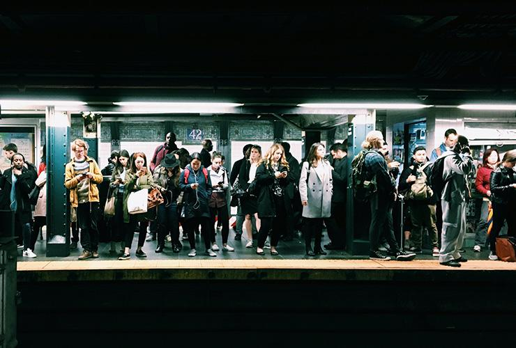 Beyond Small Talk: Becoming Willing to Explore Deeper Conversation and Connection by Judy Marano. Photograph of people waiting on a subway platform by Eddi Aguirre