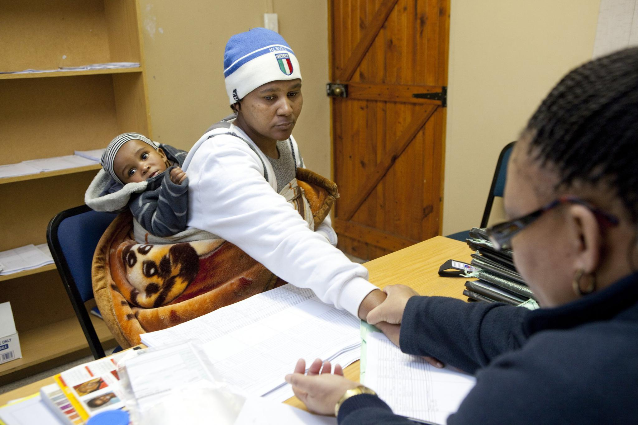A woman who was diagnosed with the HIV virus has her heart rate checked during a consult with a nurse at Ubuntu Clinic on June 3, 2013 in Cape Town, South Africa. She is a member of a support group, called an adherence club, for stable patients.