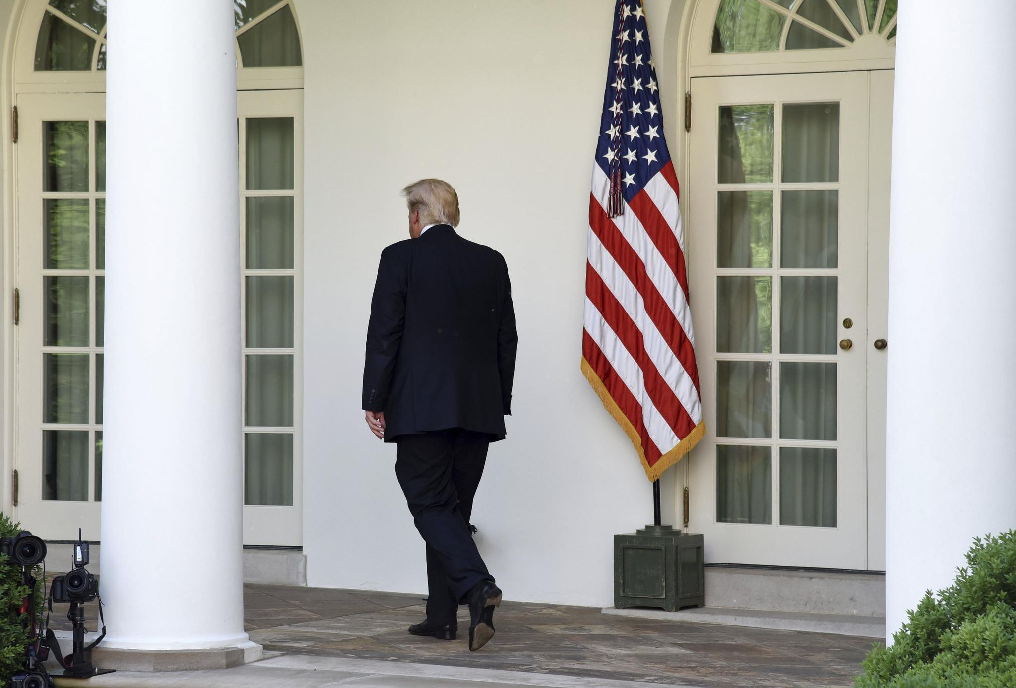 President Donald Trump walks back to the Oval Office after making a statement on The Paris Climate Change Accord in the Rose Garden of the White House, on June 1, 2017 in Washington, DC.