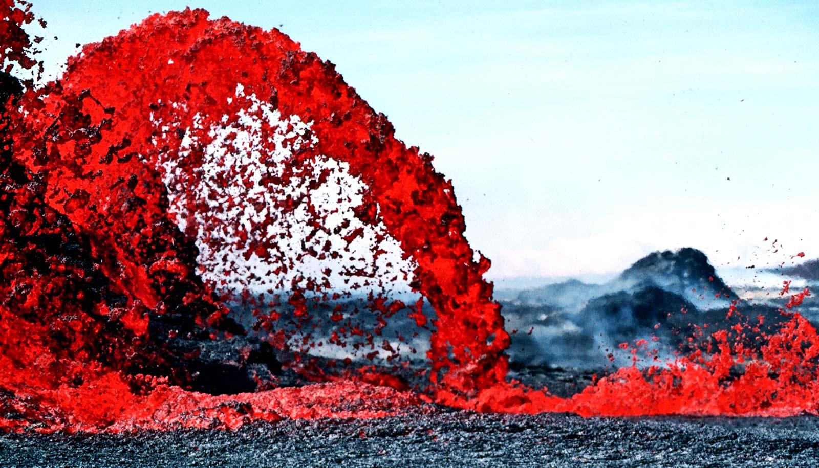 Bright red magma pours from a volcano