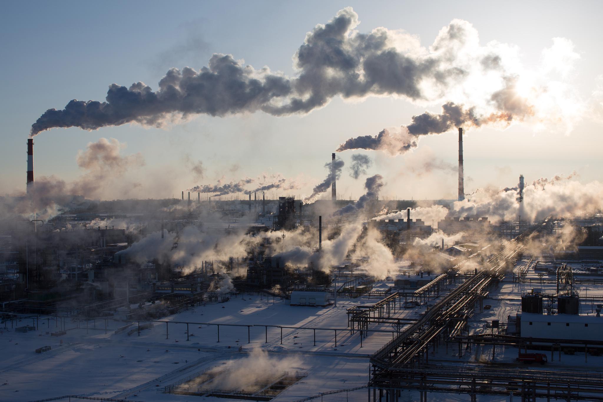 Chimneys emit vapor at Russia's Novokuybyshevsk oil refinery plant.