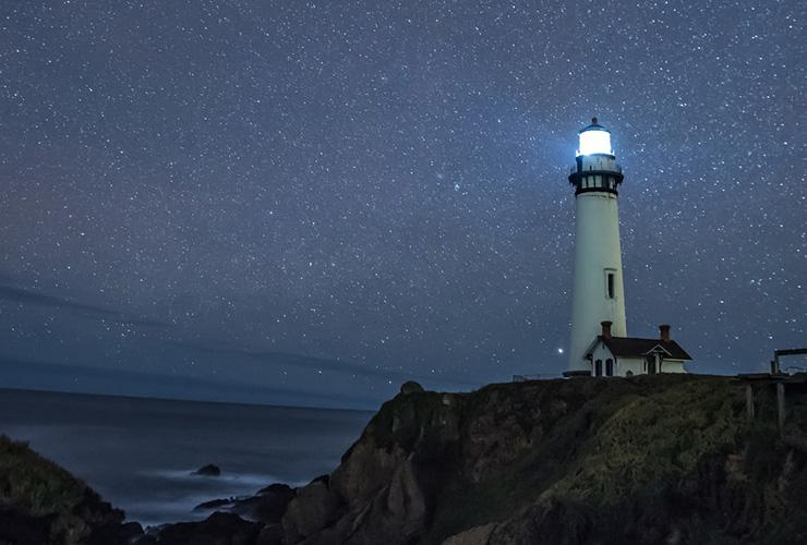 Finding Greater Meaning in Life Through Mindfulness, Stillness & Single Tasking by David Richards. Photograph of a lighthouse underneath the stars by Casey Horner