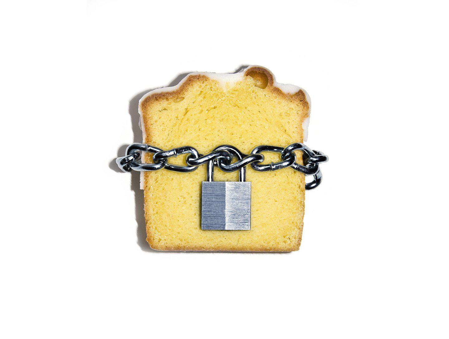 Slice of pound cake with lock and chain