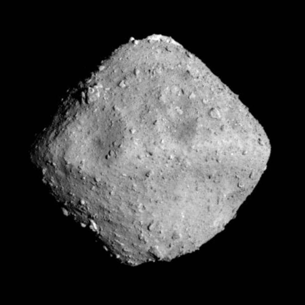 a diamond-shaped knobbly rock on a black background