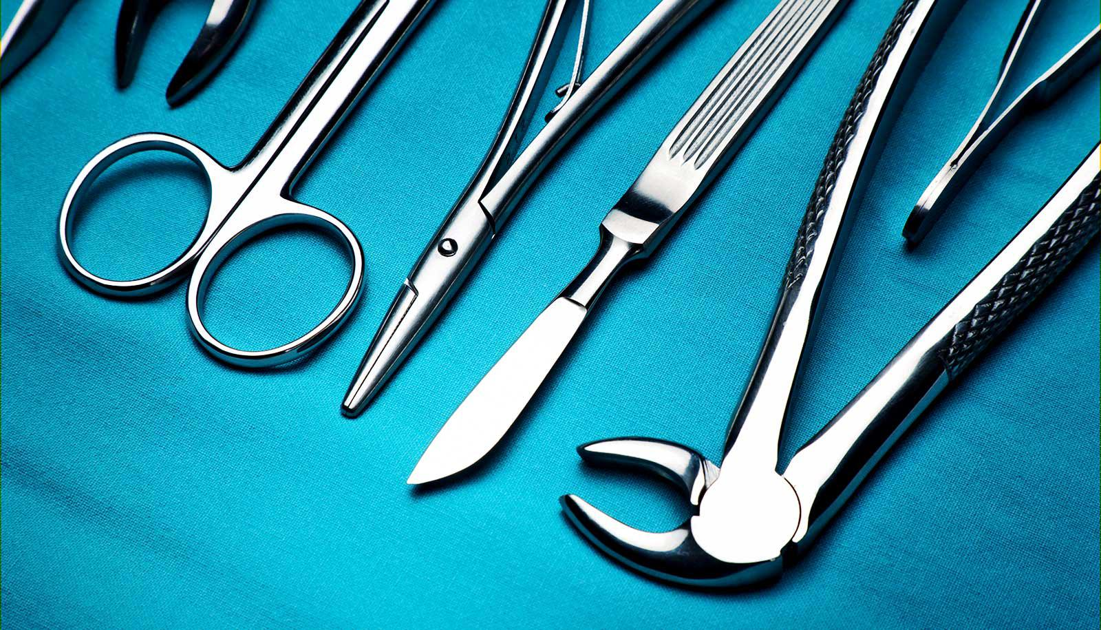 Surgical implements on a blue cloth