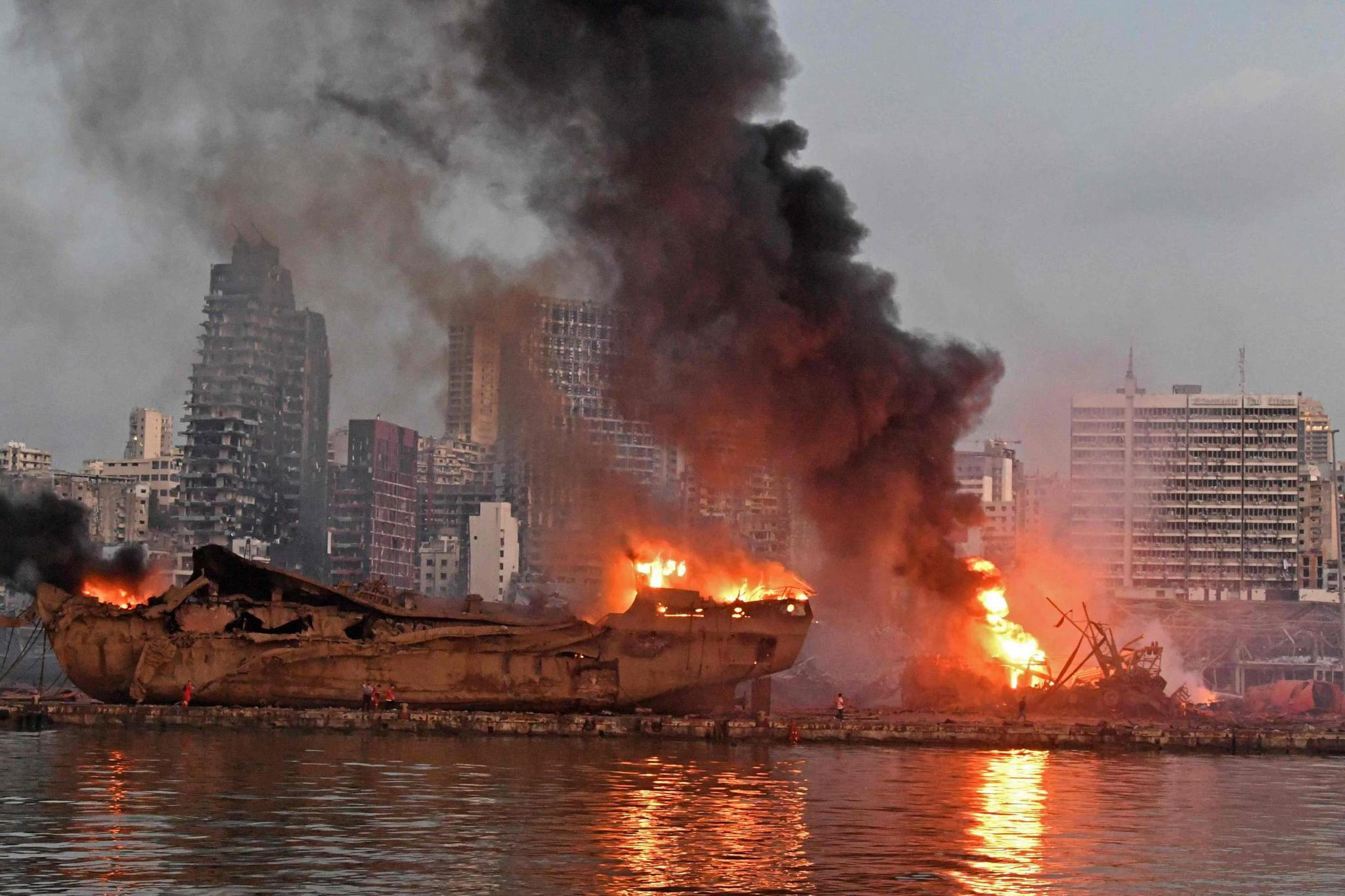 Fire at the port after the explosion (AFP via Getty Images)