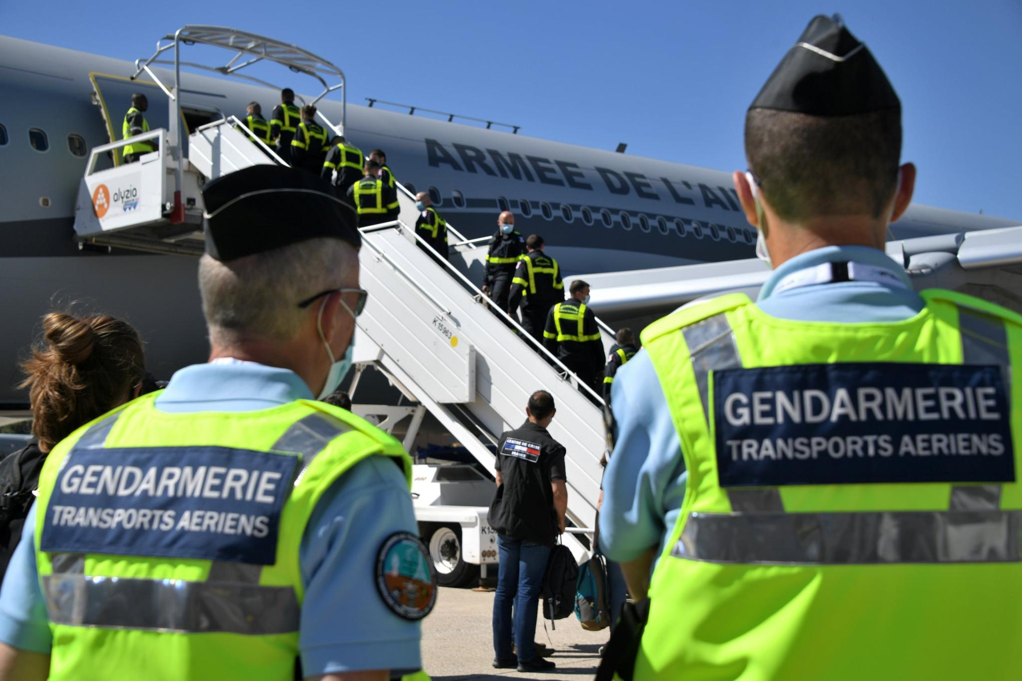 French gendarmes look at Securite Civile (Civil Security) personnel boarding an Airbus A330 as France sends search and rescue experts (REUTERS)