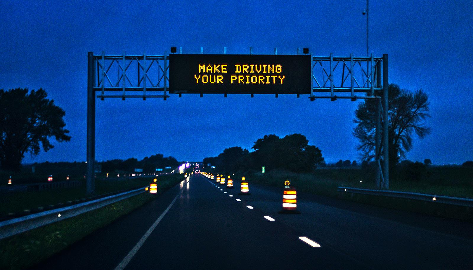 make driving your priority sign