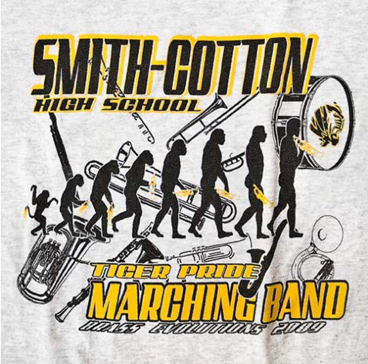 A high school marching band's T-shirt places a horn-playing <em>Homo sapiens</em> at the end of the evolutionary process.