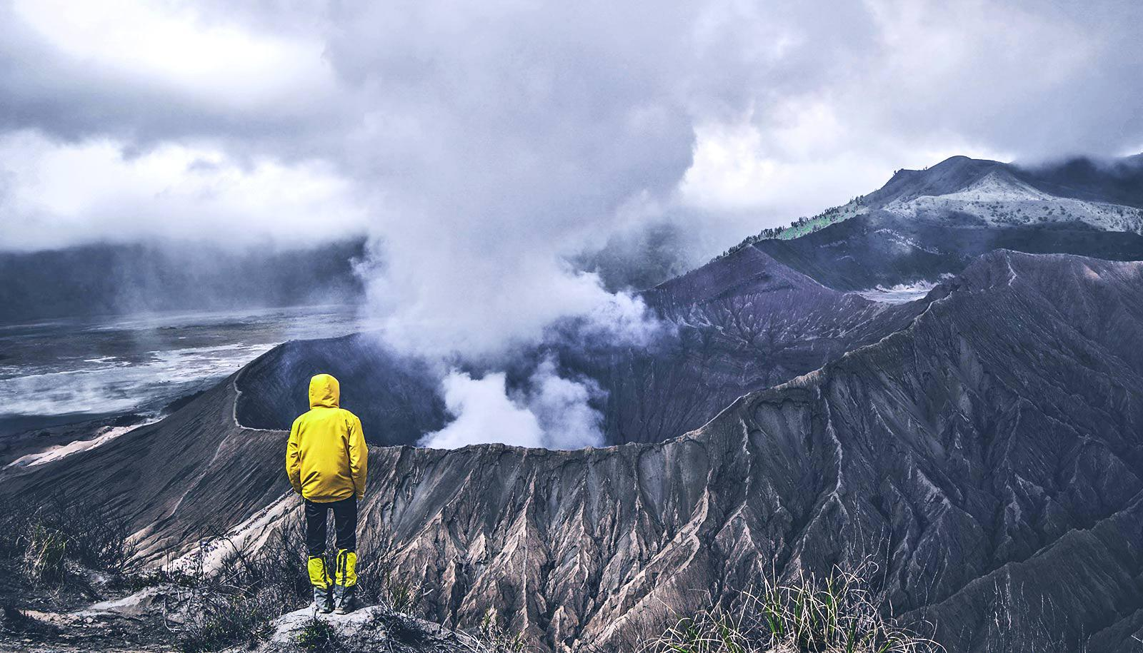 person looking at volcano
