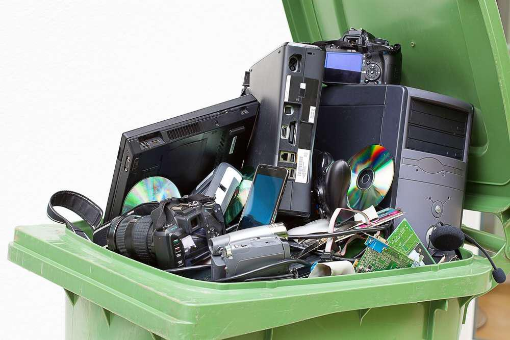 electronics in trash bin