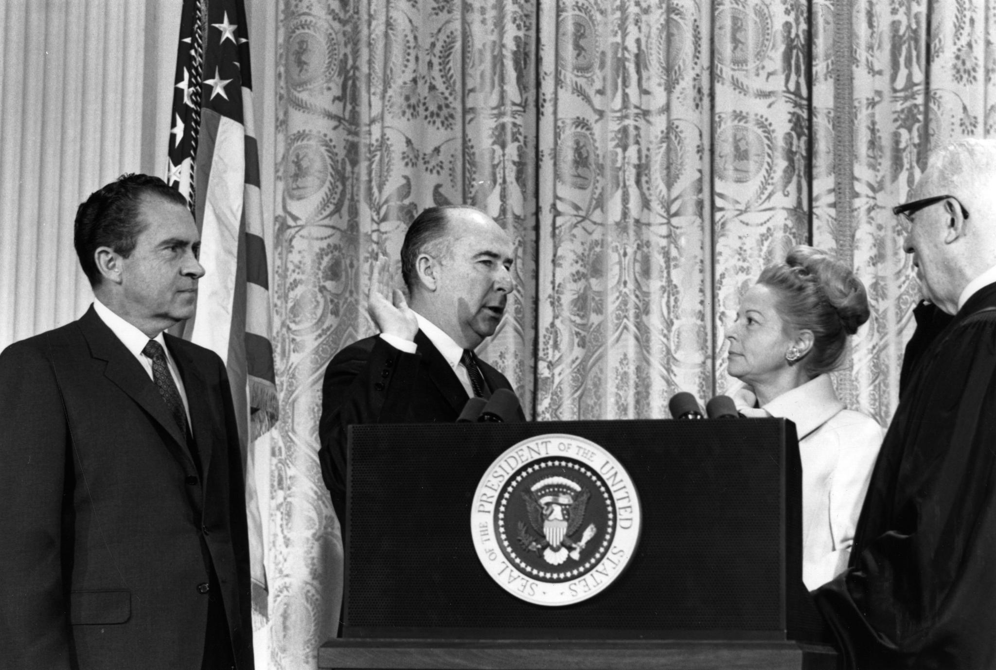 Martha Mitchell with her husband, former Attorney General John Mitchell, one of Richard Nixon's top aides, when he was being sworn in at the Senate on May 11, 1973.