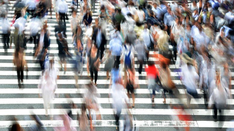Pedestrians cross a street in busy Osaka. Image from Pixabay.