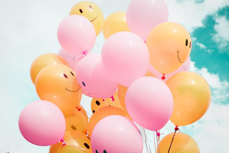 4 Ways to Choose Happiness Today, by Dain Heer. Photograph of smiley face balloons by Hybrid