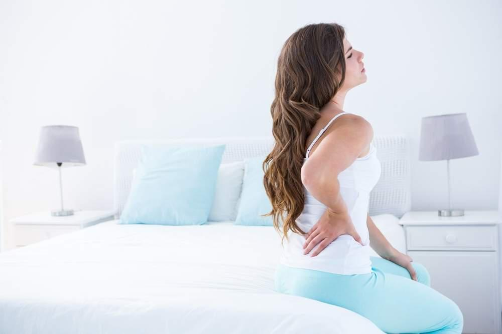 back pain on bed