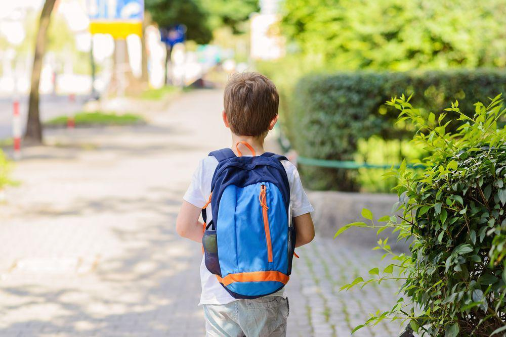 kid walking to school