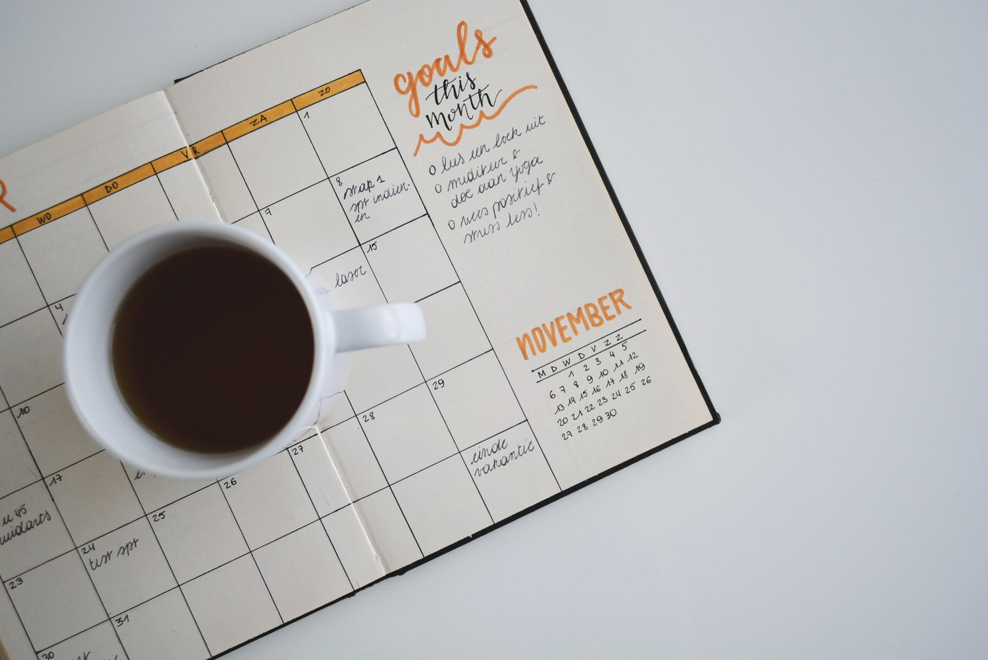 4 Keys to Creating A Lasting, Healthy Lifestyle Change by Ashley Walter. Photograph of a planner with goals written out by Estee Janssens