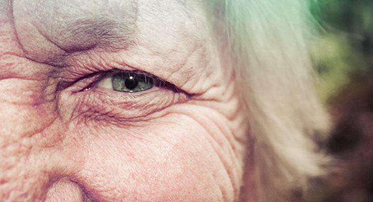 3 Reasons Why Women Over 50 Should Consume Probiotics by Lorna Frances. Up close photograph of an older woman's eye by Alipay Tonga