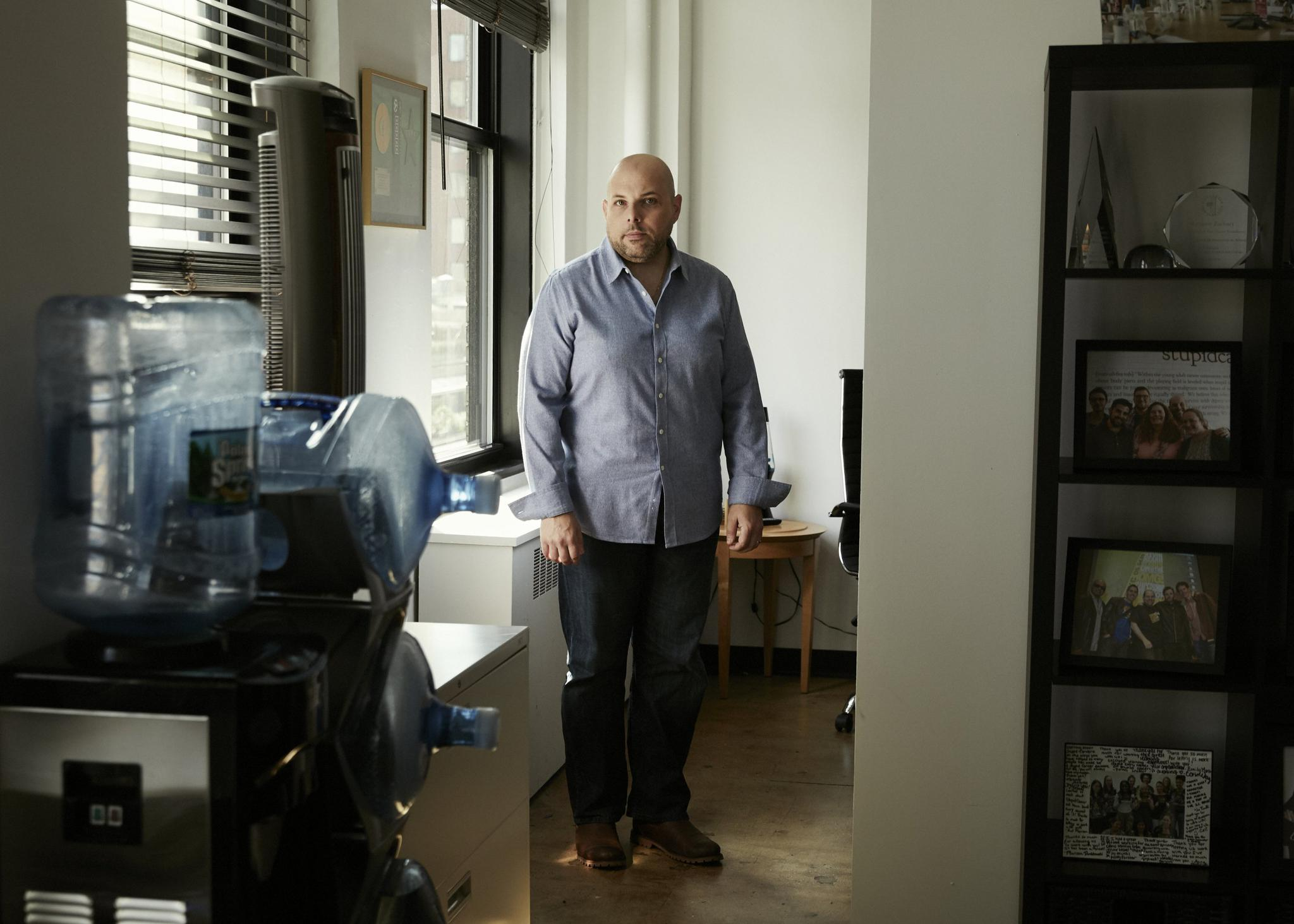 Matthew Zachary poses in the meeting room of Stupid Cancer's office in Tribeca, New York.