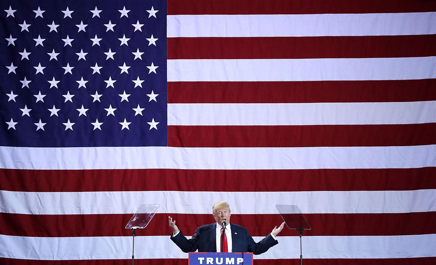 Republican presidential nominee Donald Trump addresses a campaign rally at the Deltaplex Arena October 31, 2016 in Grand Rapids, Michigan. With just eight days until the election, polls show a slight tightening in the race.