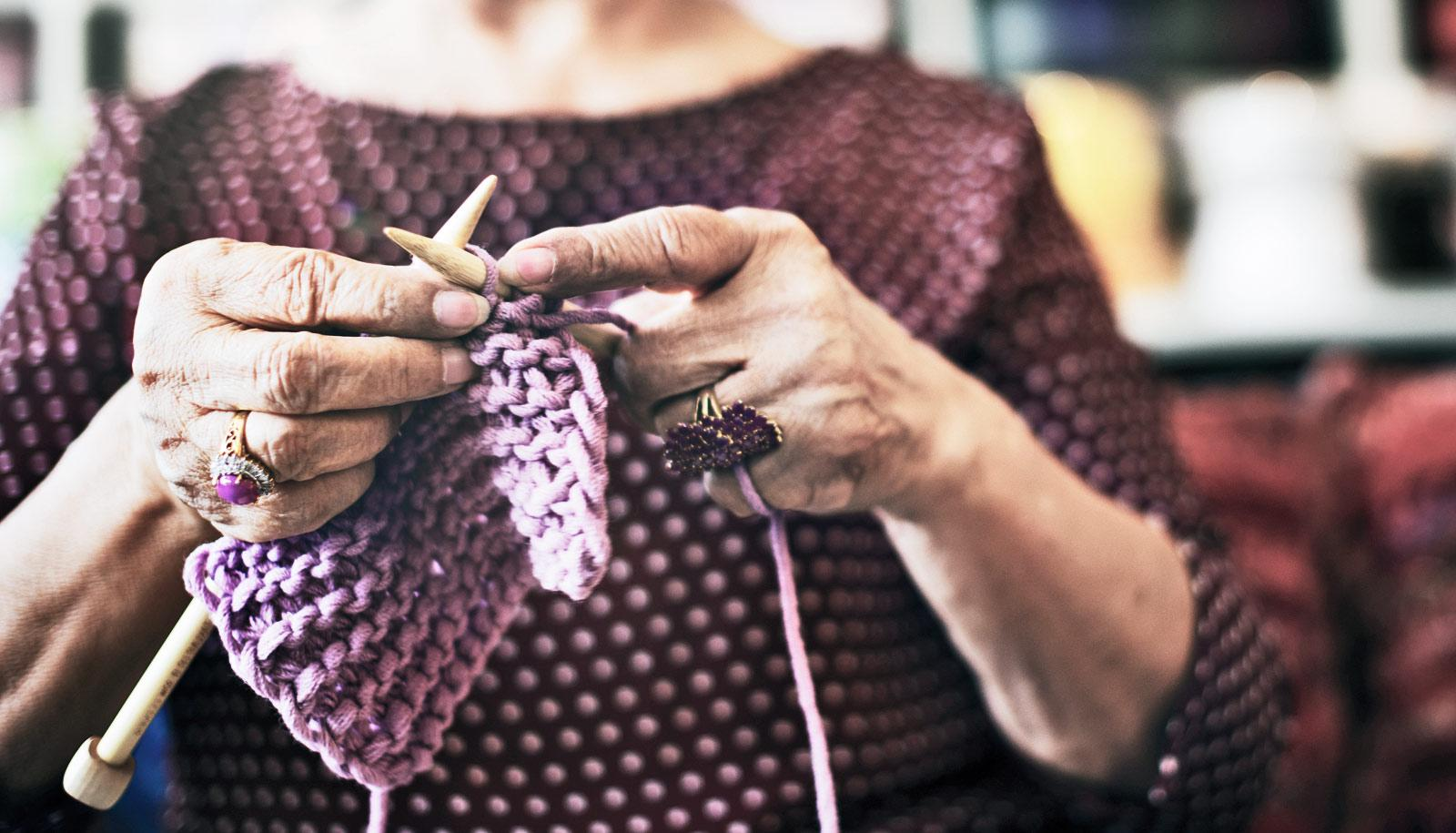 hands of elderly person knitting