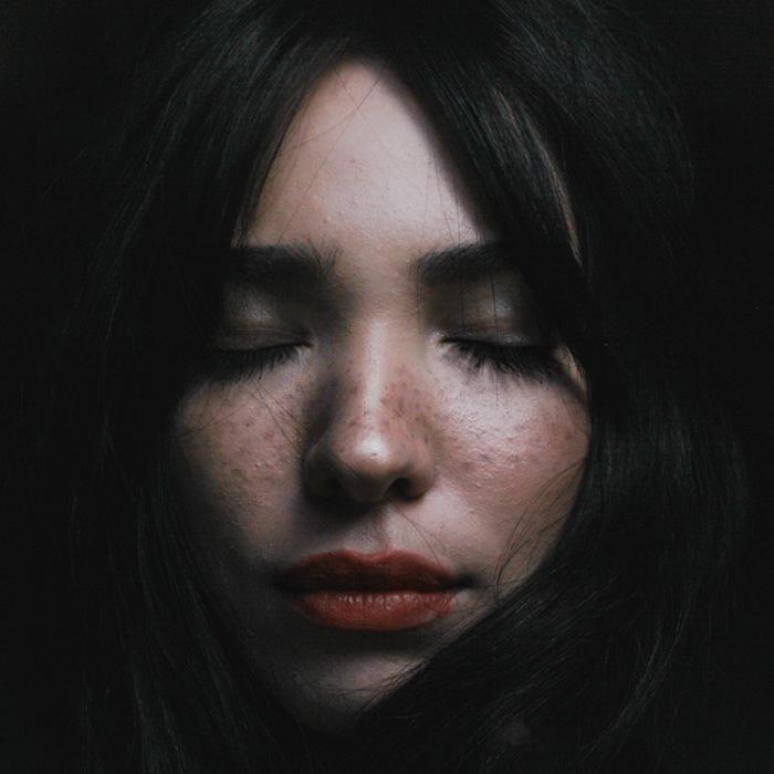 Healing chronic illness, photograph of woman's face by Zulmaury Saavedra
